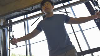 Slow motion of young Asian man exercising in the fitness gym
