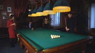 a group of friends playing Billiards