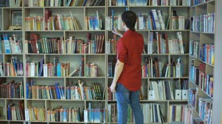 A male college student studies in the library