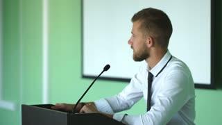 a man talks on a green background