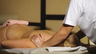 a woman lies on a massage back and relaxes