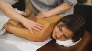 a young woman lies on a massage back and relaxes