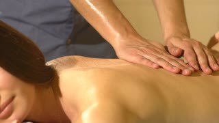 back massage with four hands in Thai massage