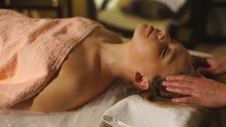 beautiful blonde girl doing a head massage