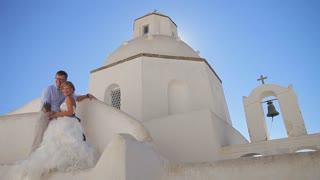 Beautiful bride and groom posing at camera