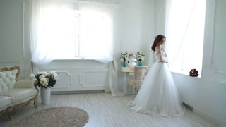 beautiful bride is standing in elegant room