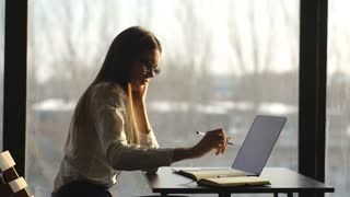 beautiful businesswoman working at laptop in office