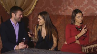 beautiful couple drinking in restaurant