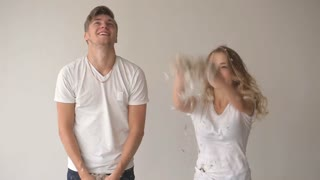beautiful couple throws feathers up