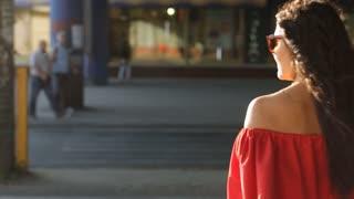 beautiful girl crossing the road