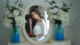 beautiful the bride looks in the mirror