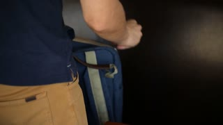 Business man opening  briefcase to take out laptop computer.