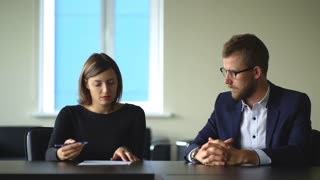 Businesswoman signing contract at interview in office