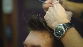close up haircut at barber shop with scissors