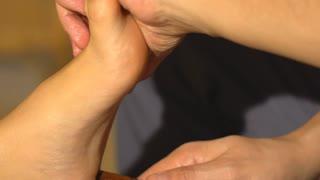 Closeup of a female feet at spa salon on pedicure procedure. Legs care concept