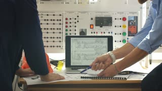 Engineer and foreman working at control room of a modern thermal power plant