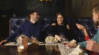 Friends at a restaurant drinking wine.