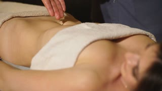 girl doing abdominal massage