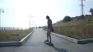 girl rides a long Board
