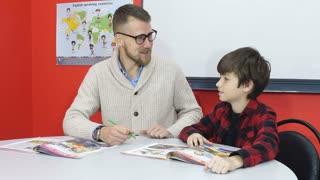Gracious teacher praises and pats on the head