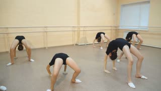 group of dancers warming up and doing stretching exercises