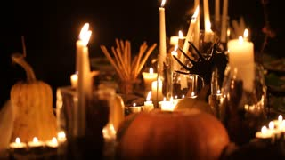 Halloween holiday table with candles and pumpkins