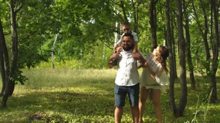 happy family having fun in the woods
