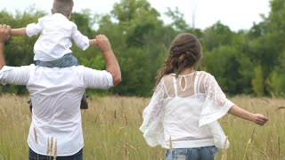 happy family with child run and have fun in the field