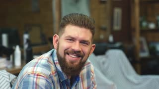 happy man smiling in a Barber shop