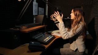Happy Radio DJ in studio talking with audience