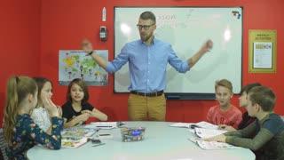 happy school children giving high five at school
