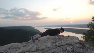 male exercisers on the top of the mountain