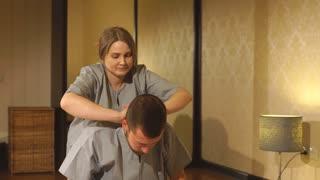 Man getting massage in spa. Female therapist