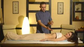 Man having oil Ayurveda spa treatment. Back and hands body part.