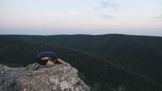 Man sitting on the top of the mountain in meditation session