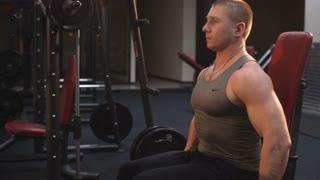 Men shakes biceps