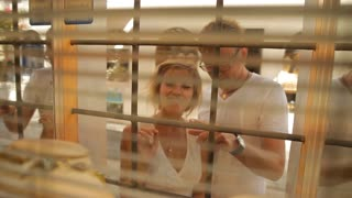 Newlyweds choosing jewelery in shop