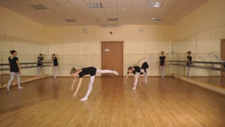 pretty young ballerinas practicing during class at a classical ballet school
