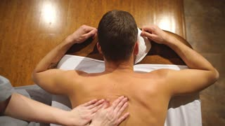 shooting from above. man doing a shoulder and back massage,relaxing,relaxation