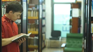 Student reading a book in the library