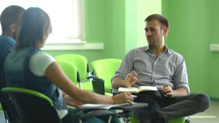 students discuss seminar lectures