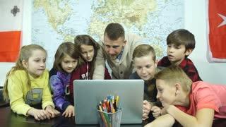Teamwork over the teacher's laptop
