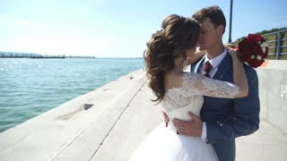 the bride and groom on the promenade