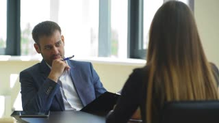the employer asks questions to the woman in the interview