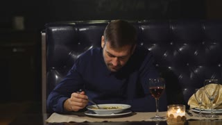 the man eats the soup at the restaurant