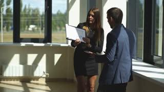 the successful businesswoman shows a graph businessman