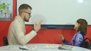 the teacher explains the information to the fingers of schoolgirl