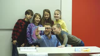 the teacher makes a selfie with students