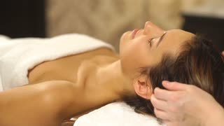 the woman doing the facial massage
