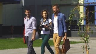 three students walking on campus